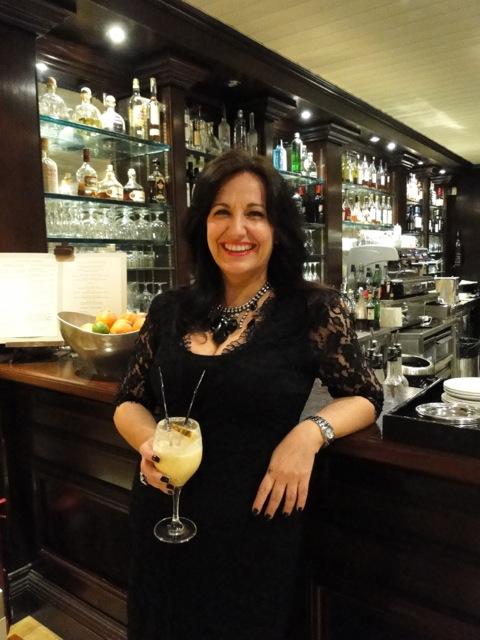 Cara Barseghian drinking a cocktail